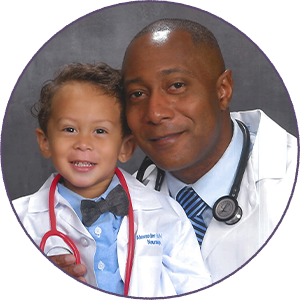 Doctor and his child dressed in white coats